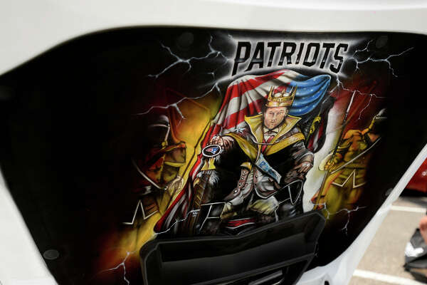 A New England Patriots-themed airbrushing under the hood of a Corvette on display during the Tri-City Corvette Club's 23rd annual Corvette show at Parkdale Mall on Saturday.  Photo taken Saturday 5/20/17 Ryan Pelham/The Enterprise