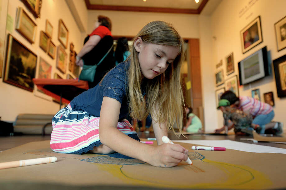 Lola McClary, 7, colors during the free family art day at Art Museum of Southeast Texas on Saturday.  Photo taken Saturday 5/20/17 Ryan Pelham/The Enterprise Photo: Ryan Pelham / ©2017 The Beaumont Enterprise/Ryan Pelham