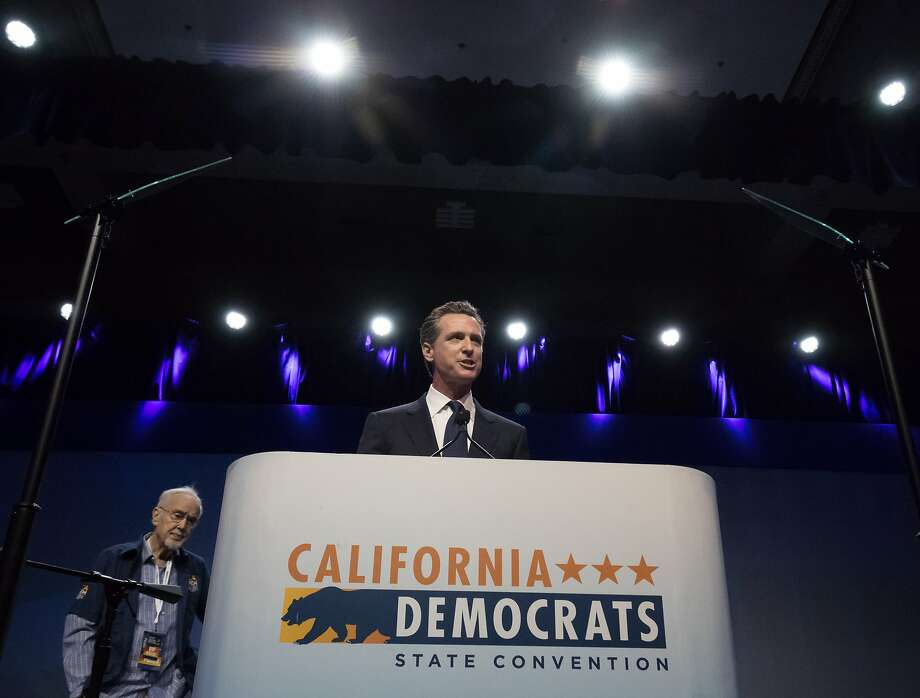 Lt. Gov. Gavin Newsom speaks at the California Democratic Party's state convention in Sacramento. Behind him is Democratic Party Chairman John Burton. Photo: Paul Kuroda, Special To The Chronicle