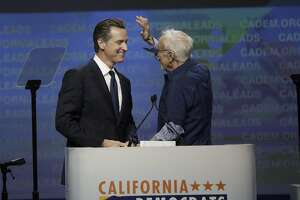John Burton kiddingly tries to mess up Lt. Gov. Gavin Newsom's hair as he introduces him to the convention floor  at the California Democrats 2017 State Convention on Saturday, May 20, 2017 in Sacramento, CA.