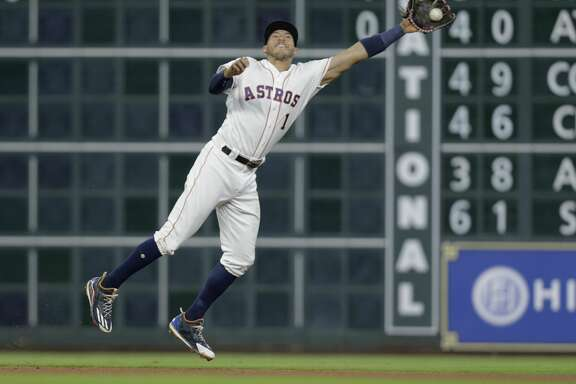 Houston Astros shortstop Carlos Correa (1) gets Cleveland Indians designated hitter Edwin Encarnacion (10) out in the top of the fourth inning on Saturday, May 20, 2017, in Houston. Indians lead the series 1-0.( Elizabeth Conley / Houston Chronicle )