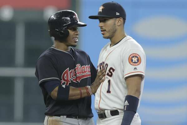 Cleveland Indians shortstop Francisco Lindor (12) jokes around with Houston Astros shortstop Carlos Correa (1) in the first inning on Saturday, May 20, 2017, in Houston. Indians lead the series 1-0.( Elizabeth Conley / Houston Chronicle )