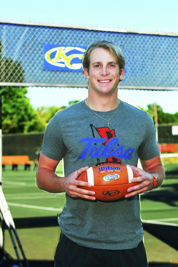 Klein Collins quarterback Bryson Powers poses in some Tulsa gear. After nearly a year and a half of being so certain he was headed to Harvard that people literally called him, 'Harvard,' Powers changed courses. Next year, Powers will head to play alongside fellow Tiger Dante Bivens for the Golden Hurricane. Photo: Tony Gaines / HCN