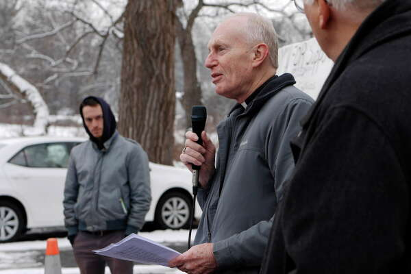 Bishop Emeritus Howard Hubbard helps to lead a religious service outside of Momentive Performance Materials on Thursday, Dec. 22, 2016, in Waterford, N.Y.  Religious leaders from the Capital Region held the service to show support for the workers of Momentive who have been on strike for over seven weeks.      (Paul Buckowski / Times Union)