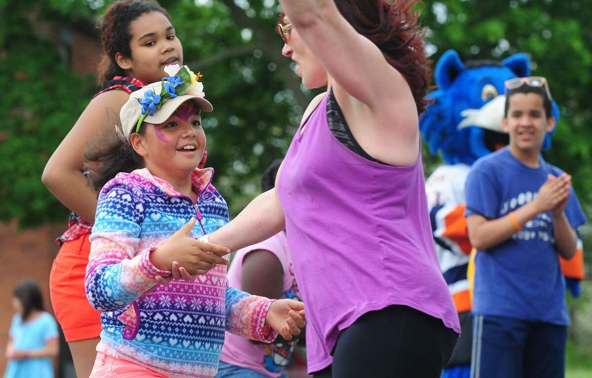 Olivia Taylor, 10, dances with Zumba instructor Rita Morgano during the Norwalk YMCA's 2nd Annual Community Celebration on Saturday, May 20, at Mt. Zion Baptist Church in Norwalk. The community celebration included activities for kids, such as arts and crafts, face painting and musical games; free health and wellness screenings and services; informational displays from local merchants; door prizes, handouts and giveaways and Zumba.