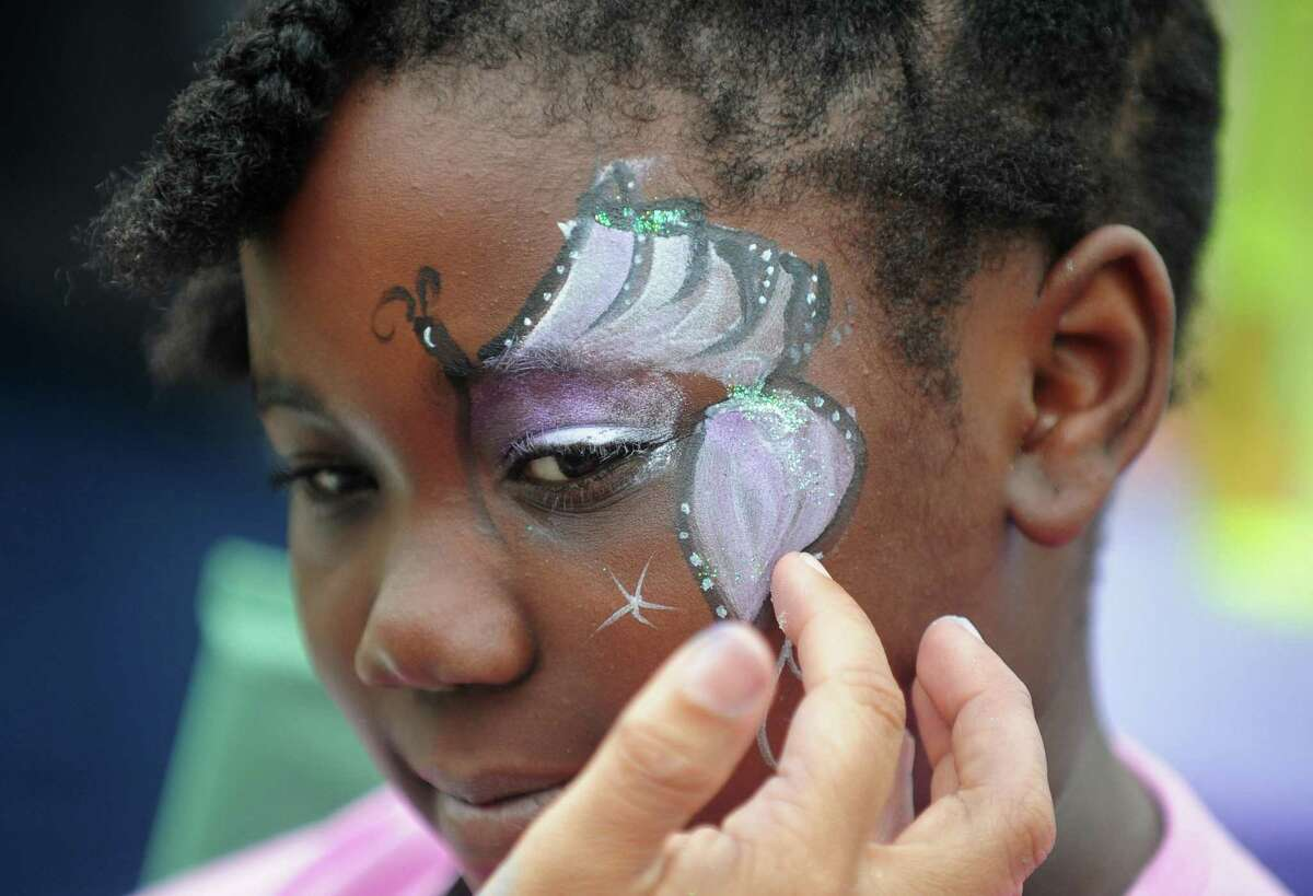 Sarae Evans, 8, gets her face painted during the Norwalk YMCA's 2nd Annual Community Celebration on Saturday, May 20, at Mt. Zion Baptist Church in Norwalk. The community celebration included activities for kids, such as arts and crafts, face painting and musical games; free health and wellness screenings and services; informational displays from local merchants; door prizes, handouts and giveaways and Zumba.