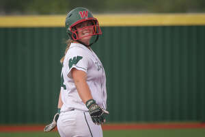 The Woodlands' Kelcy Leach (10) smiles at teammates after making it to second base during the varsity softball game against Cedar Ridge on Friday, May 19, 2017, at Mumford High School. (Michael Minasi / Chronicle)