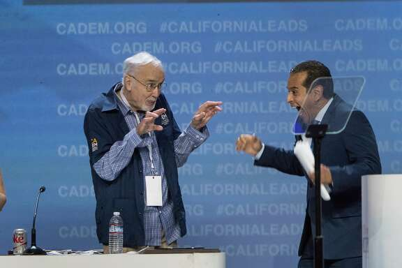 John Burton jokes with  former Los Angeles Mayor Antonio Villaraigosa after his speech at the California Democrats 2017 State Convention on Saturday, May 20, 2017 in Sacramento, CA.