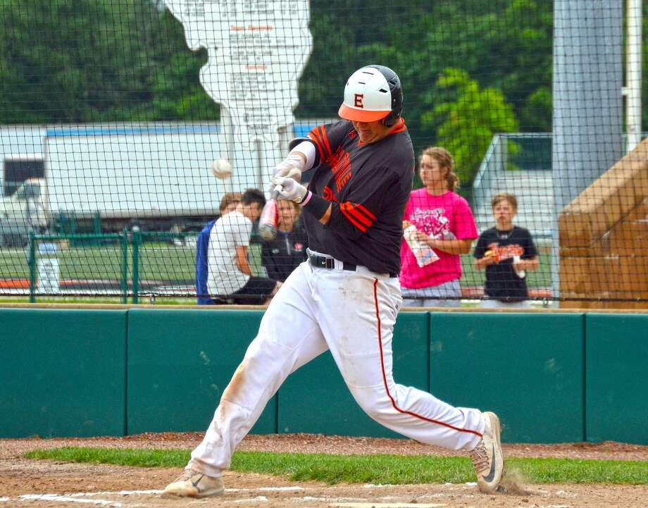 Edwardsville freshman Drake Westcott hits a solo home run in the first inning of Saturday's game at Tom Pile Field.