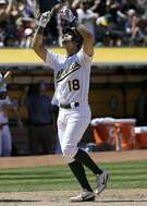 Oakland Athletics' Chad Pinder celebrates after hitting a two-run home run during the fifth inning of a baseball game against the Boston Red Sox in Oakland, Calif., Saturday, May 20, 2017. (AP Photo/Jeff Chiu)