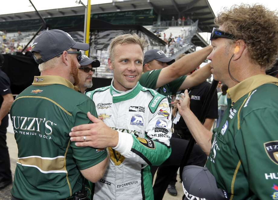 Ed Carpenter celebrates with his crew after his fast times in Indianapolis. Photo: Michael Conroy, Associated Press