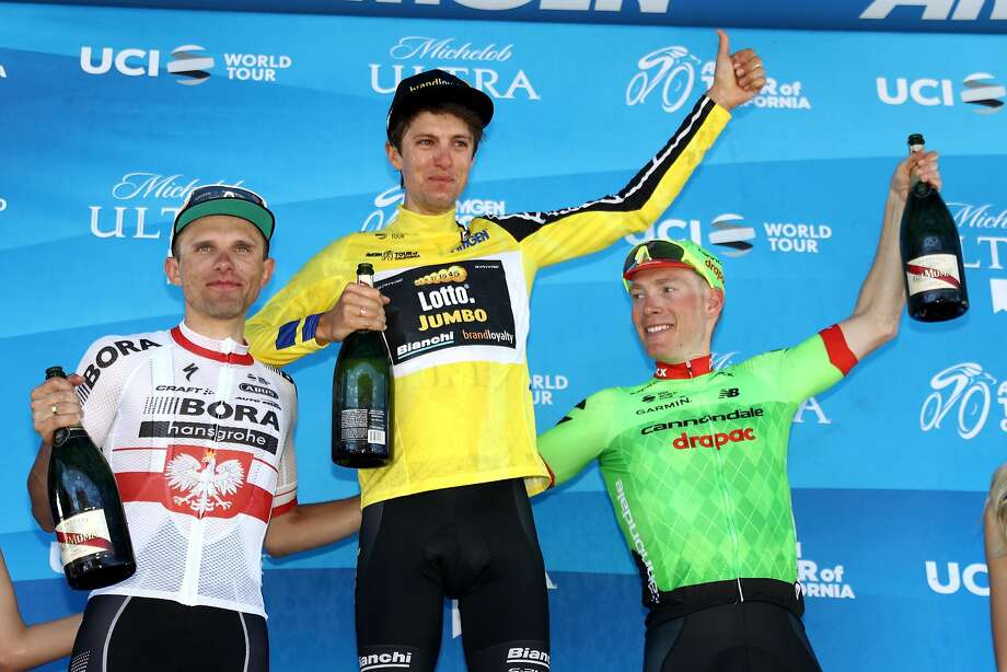 Tour of California winner George Bennett (center) offers a toast with second- place Rafal Majka (left) and third-place Andrew Talansky approving. Photo: Bryn Lennon, Getty Images