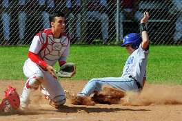 Newtown's Jason Hebner slides into home plate as Masuk catcher Enzo Merlonghi waits for the ball during SWC Baseball playoff action in Monroe, Conn., on Saturday May 20, 2017.