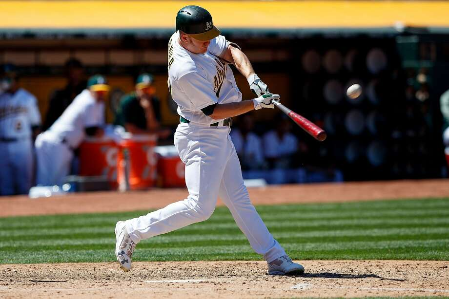 OAKLAND, CA - MAY 20:  Mark Canha #20 of the Oakland Athletics hits a home run against the Boston Red Sox during the fifth inning at the Oakland Coliseum on May 20, 2017 in Oakland, California. The Oakland Athletics defeated the Boston Red Sox 8-3. (Photo by Jason O. Watson/Getty Images) Photo: Jason O. Watson, Getty Images