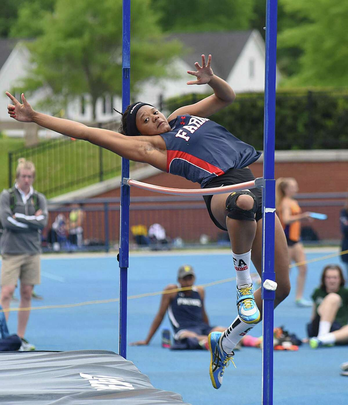 Greens Farms Academy senior high jumper Olivia Sullivan, a resident of Norwalk, clears the bar at 5-foot-2 to win the NEPSAC Division 3 championship in that event at Cheshire Academy on Saturday.Sullivan also placed second in the triple jump and third in the long jump.