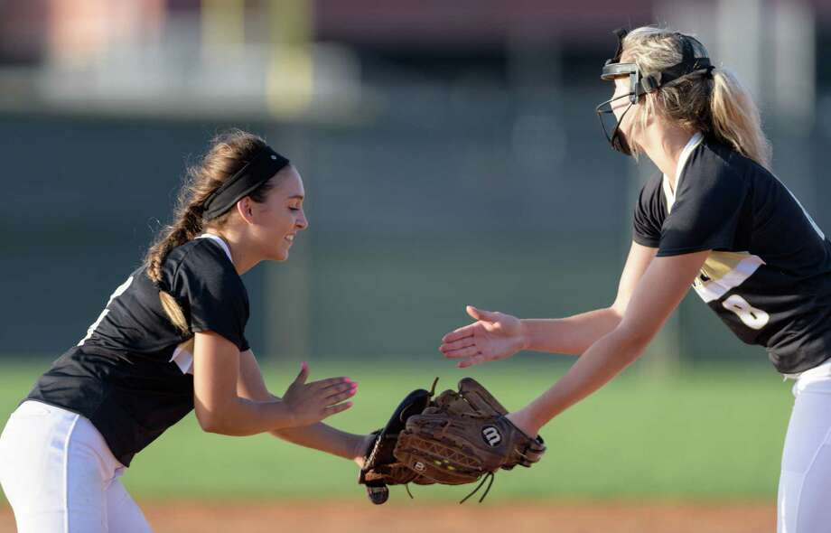 Shelby Showers (6) of the Foster Falcons congratulates Kacie Pryor (8) after striking out a Angleton Wildcats batter in a girls High School Softball game on Wednesday, April 19, 2017 at Foster High School in Richmond, Texas. Photo: Wilf Thorne / © 2017 Houston Chronicle