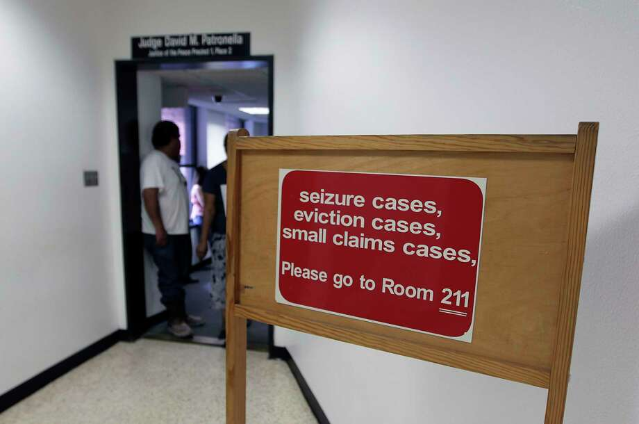 A sign directing people to Precinct 1, Place 2 Judge David Patronella's Justice of the Peace Court Monday, June 17, 2013, in Houston. ( James Nielsen / Houston Chronicle ) Photo: James Nielsen, Staff / © 2013  Houston Chronicle