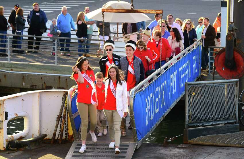 The Barnum Festival Royal Family walk onto the ferry to start the Barnum Sails the Sound event at the Bridgeport Ferry Terminal in Bridgeport, Conn., on Saturday May 20, 2017. The event kicked off with a dockside picnic dinner starting at 5pm, with the sunset cruise at 7:15pm. The $60 ticket price included two free drinks on board, plus 2 FREE round-trip walk-on ferry tickets ($54 value) to use before 12/31/17. The What Up Funk Band performed during the ferry ride. Proceeds will benefit festival activities and student scholarships.