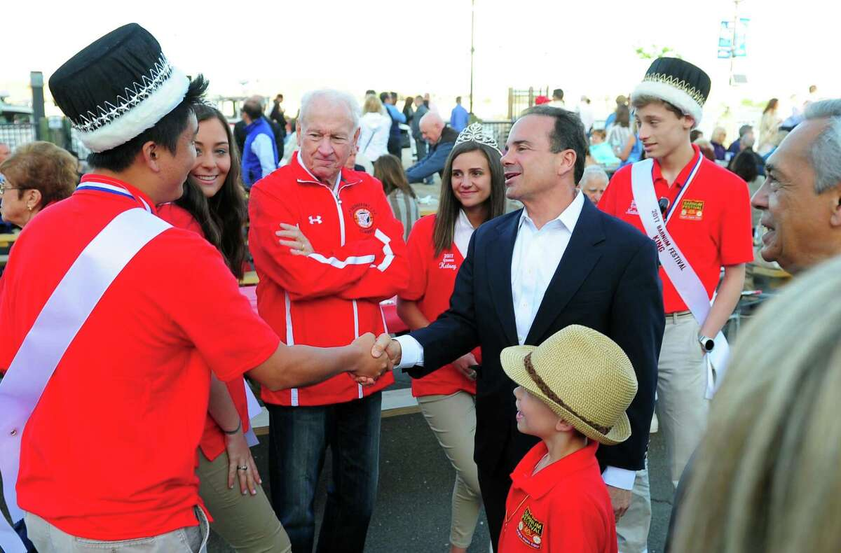 Barnum Festival Royal Family Kind King Nathaniel Larson, left, greets Bridgeport Mayor Joe Ganim at the Barnum Sails the Sound event at the Bridgeport Ferry Terminal in Bridgeport, Conn., on Saturday May 20, 2017. The event kicked off with a dockside picnic dinner starting at 5pm, with the sunset cruise at 7:15pm. The $60 ticket price included two free drinks on board, plus 2 FREE round-trip walk-on ferry tickets ($54 value) to use before 12/31/17. The What Up Funk Band performed during the ferry ride. Proceeds will benefit festival activities and student scholarships.