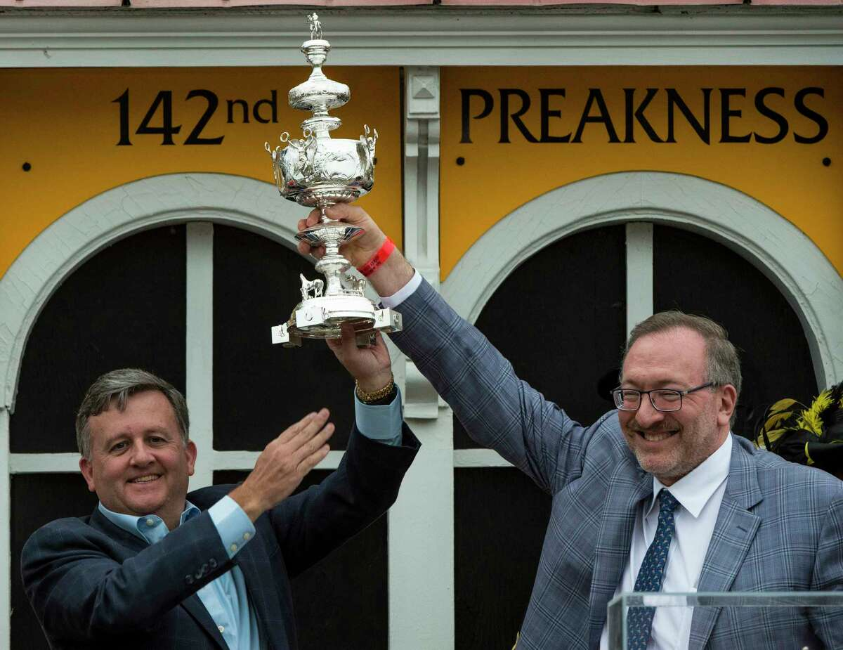 Bill Lawrence, left, had success in the Preakness with former partner Seth Klarman when Cloud Computing won the race in 2017. (Skip Dickstein/Times Union)