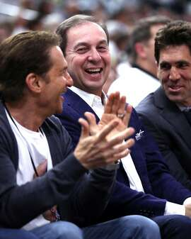 Golden State Warriors' owners Joe Lacob (center) and Peter Guber and General Manager Bob Myers (right) laugh after Stephen Curry look their way while sinking a 3-pointer in 1st quarter against San Antonio Spurs during Game 3 of NBA Western Conference Finals at AT&T Center in San Antonio, Texas, on Saturday, May 20, 2017.