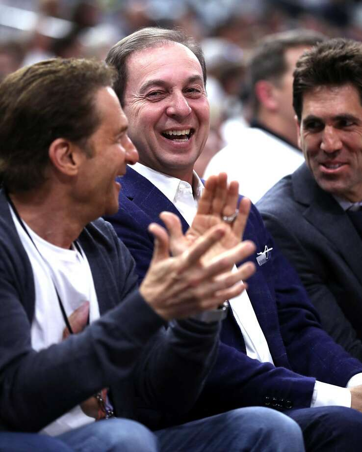 Golden State Warriors' owners Joe Lacob (center) and Peter Guber and General Manager Bob Myers (right) laugh after Stephen Curry look their way while sinking a 3-pointer in 1st quarter against San Antonio Spurs during Game 3 of NBA Western Conference Finals at AT&T Center in San Antonio, Texas, on Saturday, May 20, 2017. Photo: Scott Strazzante, The Chronicle
