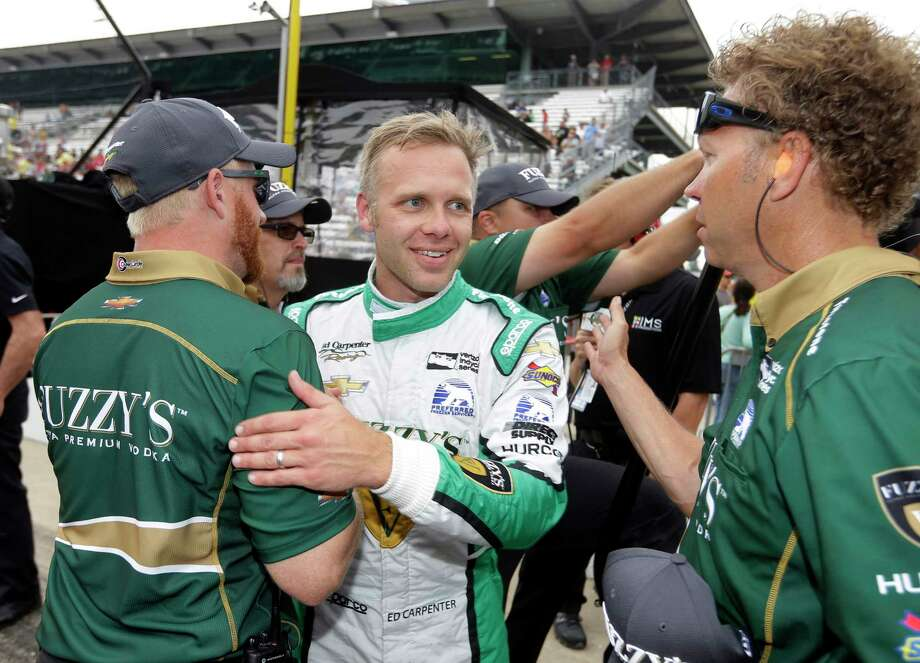 Ed Carpenter celebrates with his crew after he qualified with the fastest time during qualifications for the Indianapolis 500 IndyCar auto race at Indianapolis Motor Speedway, Saturday, May 20, 2017 in Indianapolis. (AP Photo/Michael Conroy) Photo: Michael Conroy, STF / Copyright 2017 The Associated Press. All rights reserved.