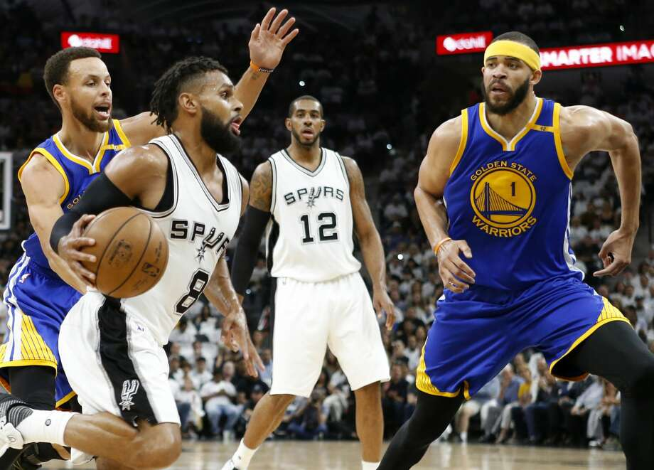 San Antonio Spurs' Patty Mills looks for room around Golden State Warriors' Stephen Curry and JaVale McGee during first half action in Game 3 of the Western Conference Finals held Saturday May 20, 2017 at the AT&T Center. Photo: Edward A. Ornelas/San Antonio Express-News