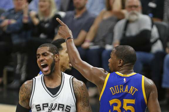 San Antonio Spurs forward LaMarcus Aldridge(12) reacts after missing a shot as Golden State Warriors forward Kevin Durant (35) gestures during the first half in Game 3 of the NBA basketball Western Conference finals on Saturday, May 20, 2017, in San Antonio. (AP Photo/Ronald Cortes)