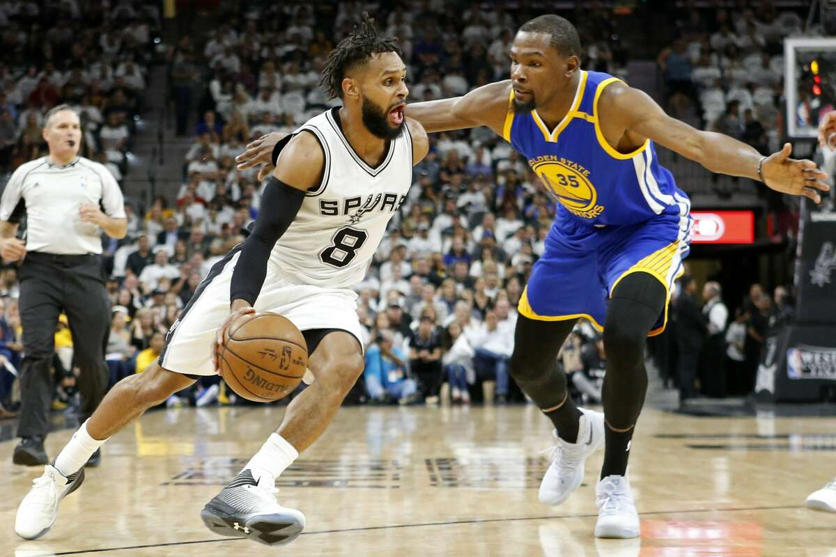 San Antonio Spurs' Patty Mills looks for room around Golden State Warriors' Kevin Durant during first half action in Game 3 of the Western Conference Finals held Saturday May 20, 2017 at the AT&T Center.