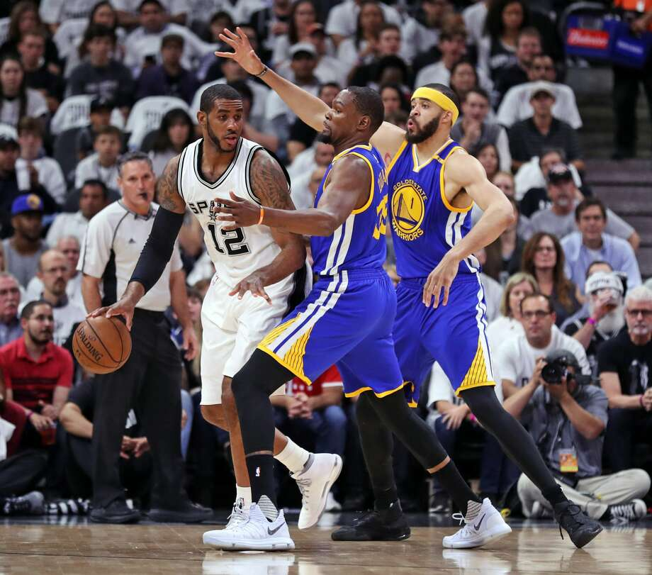 Golden State Warriors' Kevin Durant and JaVale McGee guard San Antonio Spurs' LaMarcus Aldridge in 1st quarter during Game 3 of NBA Western Conference Finals at AT&T Center in San Antonio, Texas, on Saturday, May 20, 2017. Photo: Scott Strazzante/The Chronicle