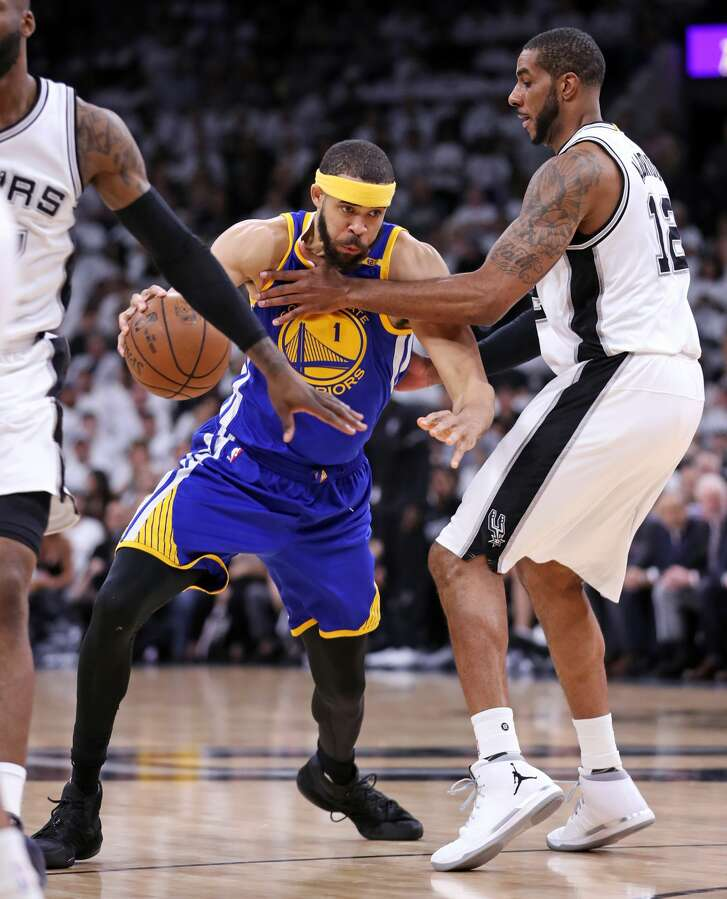 Golden State Warriors' JaVale McGee drives against San Antonio Spurs' LaMarcus Aldridge in 1st quarter during Game 3 of NBA Western Conference Finals at AT&T Center in San Antonio, Texas, on Saturday, May 20, 2017.