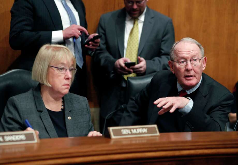 FILE - In this Jan. 31, 2017 file photo, Senate Health, Education, Labor, and Pensions Committee Chairman Sen. Lamar Alexander, R-Tenn., accompanied by the committee's ranking member Sen. Patty Murray, D-Wash. speaks on Capitol Hill in Washington. In closed-door meetings, Senate Republicans are trying to write legislation dismantling President Barack Obama's health care law. They would substitute their own tax credits, ease coverage requirements and cut the federal-state Medicaid program for the poor and disabled that Obama enlarged. Photo: Alex Brandon / Copyright 2017 The Associated Press. All rights reserved.