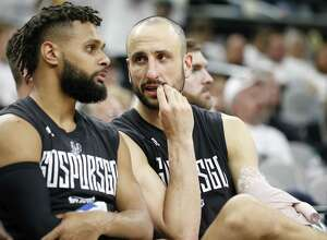 San Antonio Spurs' Patty Mills and Manu Ginobili talk on the bench late in Game 3 of the Western Conference Finals against the Golden State Warriors held Saturday May 20, 2017 at the AT&T Center. The Warriors won 120-108.