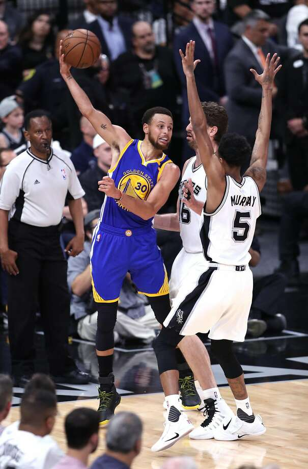Golden State Warriors' Stephen Curry passes over San Antonio Spurs' Pau Gasol and Dejounte Murray in 3rd quarter of Warriors' 120-108 win during Game 3 of NBA Western Conference Finals at AT&T Center in San Antonio, Texas, on Saturday, May 20, 2017. Photo: Scott Strazzante, The Chronicle