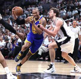 Golden State Warriors' David West drives on San Antonio Spurs' Pau Gasol in 4th quarter during Warriors' 120-108 win in Game 3 of NBA Western Conference Finals at AT&T Center in San Antonio, Texas, on Saturday, May 20, 2017.