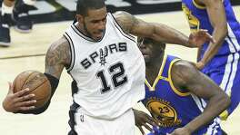 LaMarcus Aldridge battles to get into position against Draymond Green as the Spurs host Golden State in Game 3 of the Western Conference finals at the AT&T Center on May 20, 2017.