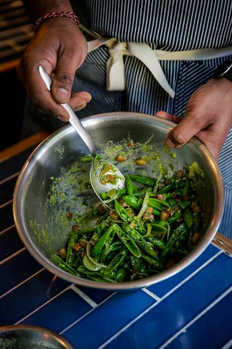 Mixing the dressing into the sugar snap pea salad. Photo: Gabrielle Lurie, The Chronicle