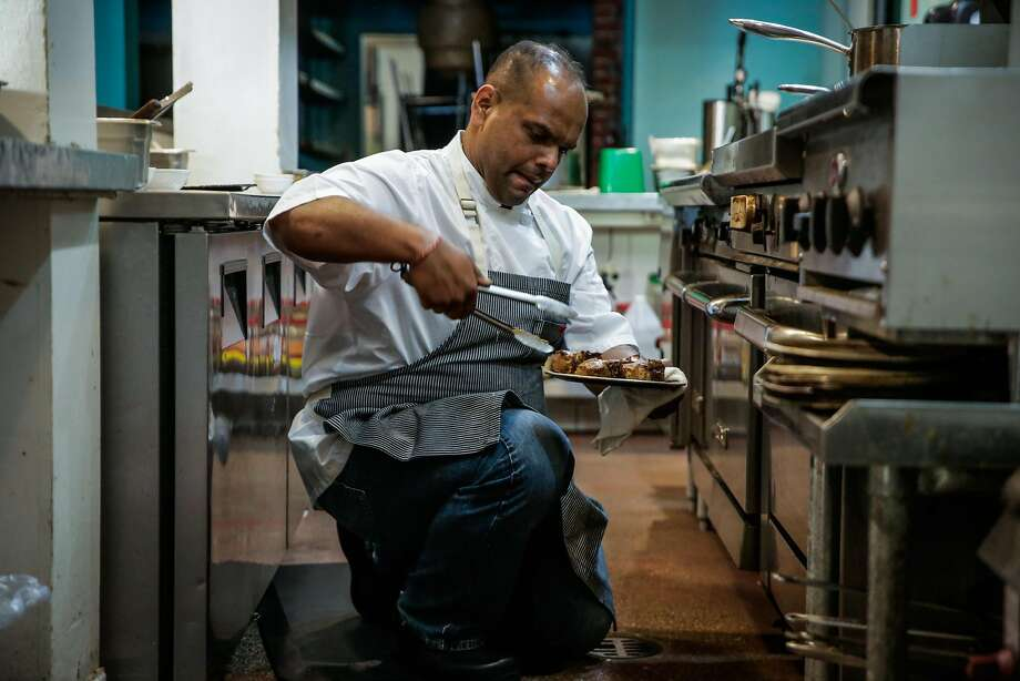 Chef Rupam Bhagat turns over the lamb meat. Photo: Gabrielle Lurie, The Chronicle