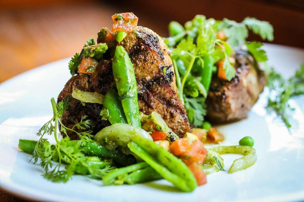 The grilled lamb T-bone and sugar snap pea salad dish at Dum Indian Restaurant in San Francisco, California, on Monday, May 8, 2017.