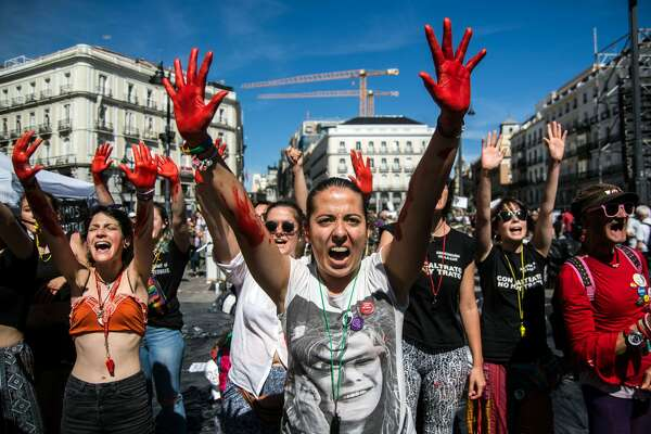 MADRID, SPAIN - 2017/05/20: Women with their hands painted in red protesting against gender violence demanding to all political parties to take actions. (Photo by Marcos del Mazo/LightRocket via Getty Images)
