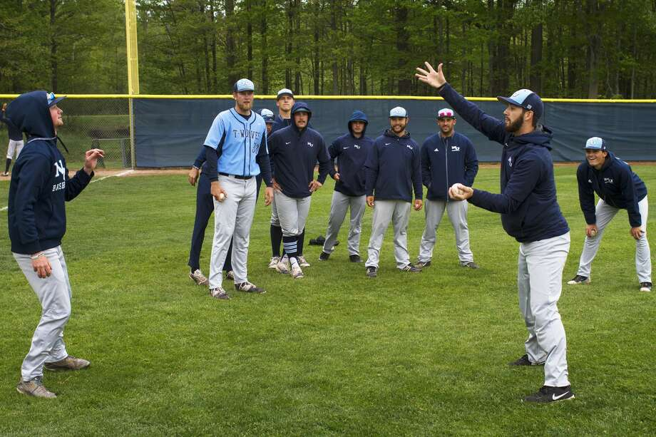 Northwood University baseball players warm up playing a hand eye coordination game before playing in a game against Drury at Northwood on Friday. Photo: Theophil Syslo