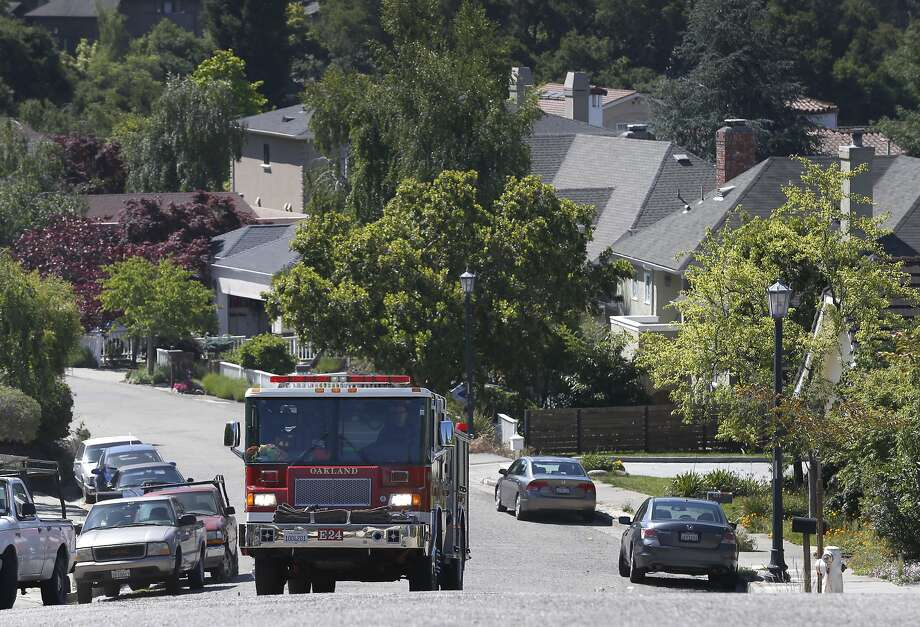 Firefighters from Station 24 conduct property inspections on Mountain Boulevard in Oakland. Photo: Paul Chinn, The Chronicle