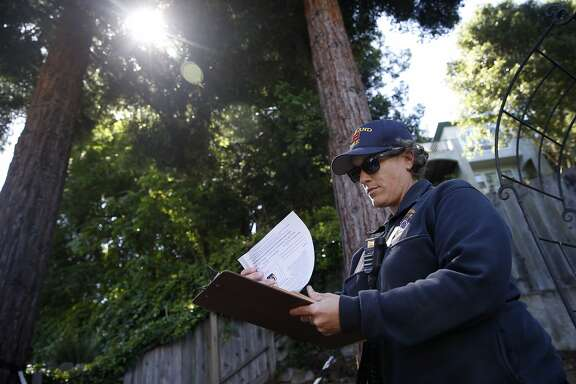 Oakland firefighter Megan Bryan conducts an inspection for vegetation management compliance in the backyard of a home on Mountain Boulevard in Oakland, Calif. on Thursday, May 18, 2017.