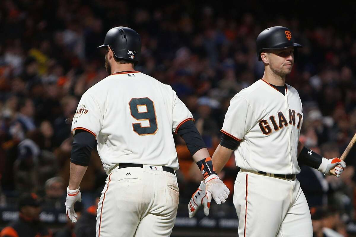 SAN FRANCISCO, CA - MAY 16: Brandon Belt #9 of the San Francisco Giants celebrates with Buster Posey #28 of the San Francisco Giants after scoring a solo home run in the fourth inning against the Los Angeles Dodgers at AT&T Park on May 16, 2017 in San Francisco, California. (Photo by Lachlan Cunningham/Getty Images)