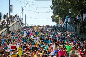 People run on Hayes Street as they participate in the Bay to Breakers annual race in San Francisco, California, on Sunday, May 21,2017.
