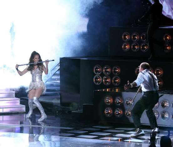UNIVERSAL CITY, CA - JUNE 06:  Jennifer Lopez (L) and Tom Cruise perform onstage at the 2010 MTV Movie Awards held at the Gibson Amphitheatre at Universal Studios  on June 6, 2010 in Universal City, California.  (Photo by Christopher Polk/Getty Images) *** Local Caption *** Tom Cruise;Jennifer Lopez Photo: Christopher Polk, Getty Images / 2010 Getty Images