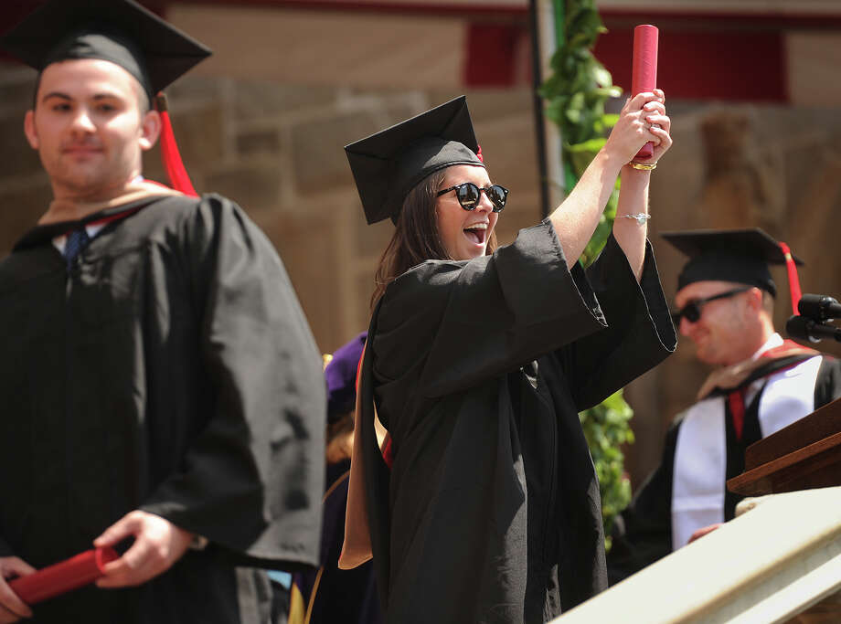 Graduate Claire Holleran swings for the fences with her diploma during Fairfield University's Commencement in Fairfield, Conn. on Sunday, May 21, 2017. Photo: Brian A. Pounds, Hearst Connecticut Media / Connecticut Post