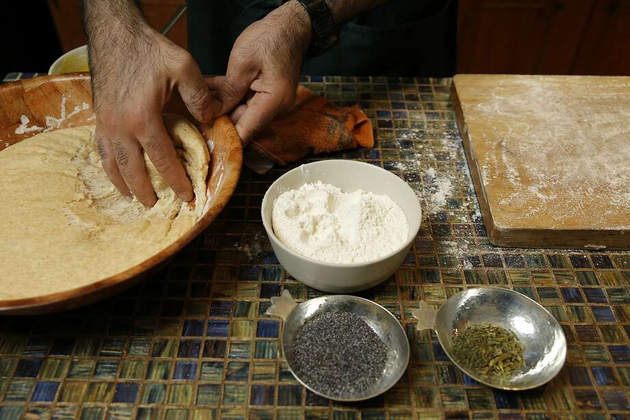 Hanif Sadr mixes dough, left, and takes freshly baked kolaas, above, from the oven. Photo: Santiago Mejia, The Chronicle