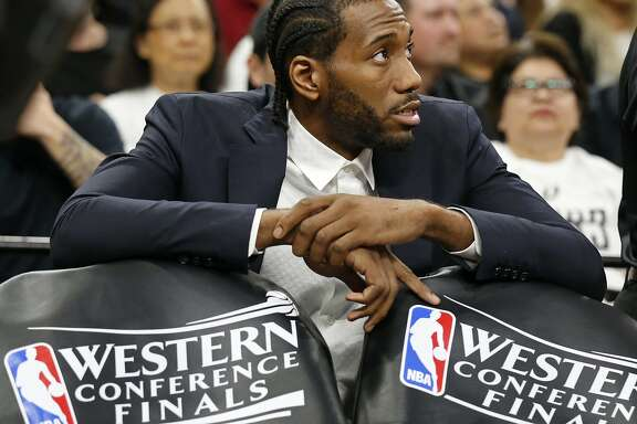 San Antonio Spurs' Kawhi Leonard sits behind the bench during a timeout in first half action of Game 3 in the Western Conference Finals against the Golden State Warriors held Saturday May 20, 2017 at the AT&T Center.